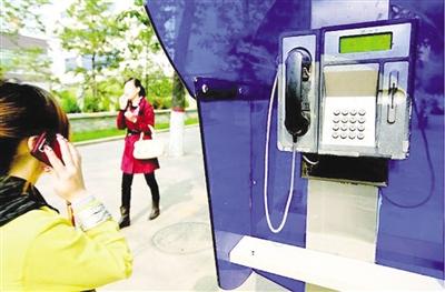 市民:IC卡电话亭该拆了